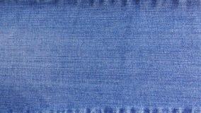 Textura da sarja de Nimes das calças de brim com as emendas em superior e em inferior, fundo, textura fotos de stock royalty free