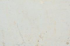 A textura da superfície da parede velha da construção, lá é fraturas, quebras, divórcios da cor e depósitos de sal fotos de stock