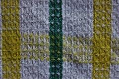 Textura da tela branca com as listras amarelas e verdes imagens de stock