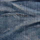 Textura das calças de brim do vintage com arrastado. imagem de stock royalty free