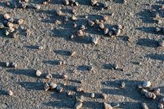Textura das pedras no asfalto Fotografia de Stock