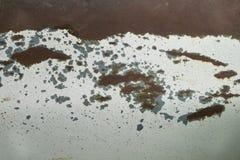 Textura de aço da corrosão da oxidação na superfície branca velha do carro fotografia de stock