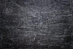 Textura de acero dañada, fondo oscuro del metal con los rasguños en t Imagen de archivo