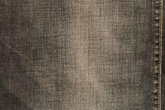 Textura de calças de brim pretas Fundo natural da sarja de Nimes Fim acima foto de stock