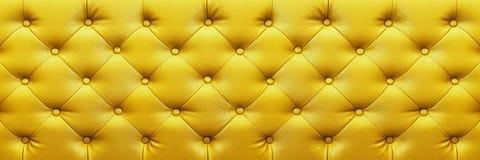textura de couro amarela elegante horizontal com os botões para o backg imagem de stock