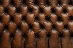 Textura de couro marrom luxuosa do fundo do sofá Foto de Stock Royalty Free