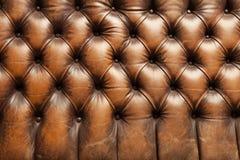 Textura de couro marrom luxuosa do fundo do sofá Imagem de Stock Royalty Free