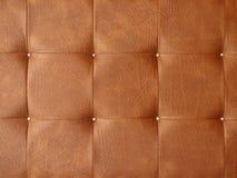 Textura de estofamento do couro de Brown Fotos de Stock