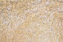 Textura de la agua y de la arena de mar Imagenes de archivo