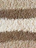 Textura de la alfombra de Brown y de Creame imagen de archivo libre de regalías