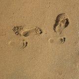 Textura de la arena con pasos del pie fotos de archivo libres de regalías