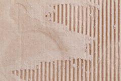 Textura de la caja de papel marrón o de la cartulina con rasgado Imagen de archivo libre de regalías