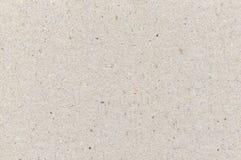 Textura de la cartulina del papel de embalaje, fondo texturizado áspero ligero del espacio de la copia, gris, gris, marrón, moren Imagenes de archivo