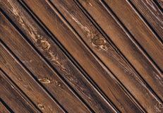 Textura de la cerca de madera vieja con los tableros oblicuos foto de archivo libre de regalías
