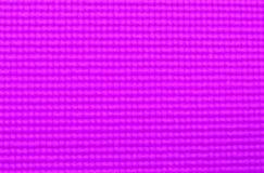 Textura de la estera púrpura de la yoga del color para el fondo y el diseño foto de archivo libre de regalías