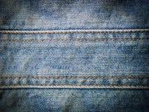 Textura de la mezclilla azul fotos de archivo