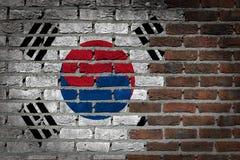 Textura de la pared de ladrillo con la bandera Fotografía de archivo
