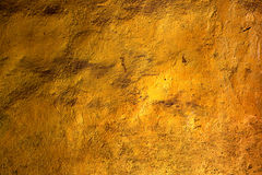 Textura de la pared del oro Imagenes de archivo