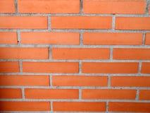 Textura de la pared de ladrillo del rojo anaranjado de la gestión del pago Fotografía de archivo
