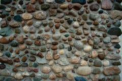 Textura de la pared de la roca - fachada de piedra del adoquín Imágenes de archivo libres de regalías
