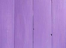 Textura de la pared vieja del tablón de la pintura púrpura del color Fotos de archivo