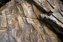Textura de la piedra de la pizarra en los catedrales Ribadeo de los las de Playa imagenes de archivo