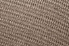 Textura de la tela de Brown de la harpillera Fondo de la ropa Contexto del pa?o Modele del despido, empaquetando Primer de lino d fotografía de archivo