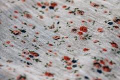 Textura de la tela con las flores Imágenes de archivo libres de regalías
