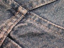 Textura de la tela de los pantalones vaqueros del dril de algodón Imagenes de archivo