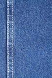 Textura de la tela de los tejanos con la puntada Fotografía de archivo libre de regalías