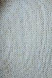Textura de la tela del blanco gris de un pedazo de paño de lana Fotos de archivo