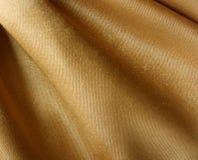 Textura de la tela del oro Fotografía de archivo
