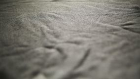 Textura de la tela, fondo de la materia textil Primer de la materia textil, tela de lino gris con textura grande Incluso fondo li almacen de video