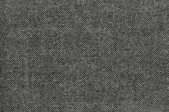 Textura de la tela granulosa con las motas negras Foto de archivo