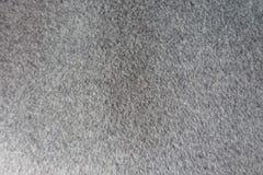 Textura de la tela de lana gris gruesa de la capa desde arriba Foto de archivo