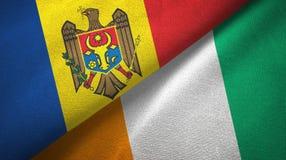 Textura de la tela de materia textil de las banderas de Costa de Marfil dos del Moldavia y de Cote d ?Ivoire libre illustration