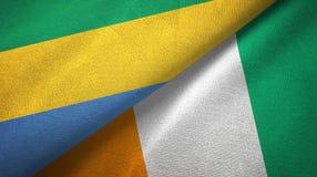 Textura de la tela de materia textil de las banderas de Costa de Marfil dos de Gab?n y de Cote d ?Ivoire ilustración del vector