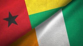 Textura de la tela de materia textil de las banderas de Costa de Marfil dos de Guinea-Bissau y de Cote d ?Ivoire stock de ilustración