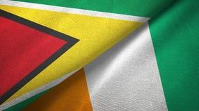 Textura de la tela de materia textil de las banderas de Costa de Marfil dos de Guyana y de Cote d ?Ivoire ilustración del vector