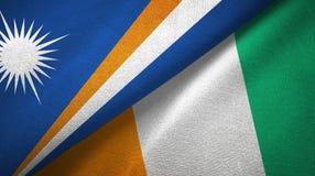 Textura de la tela de materia textil de las banderas de Costa de Marfil dos de Marshall Islands y de Cote d ?Ivoire libre illustration
