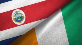 Textura de la tela de materia textil de las banderas de Costa de Marfil dos de Costa Rica y de Cote d ?Ivoire ilustración del vector