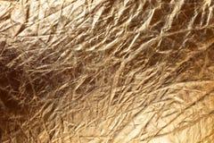 Textura de la tela metallizic de oro Foto de archivo libre de regalías