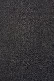 Textura de la tela negra de los pantalones vaqueros Foto de archivo