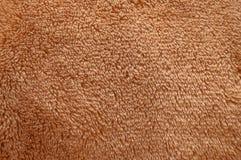 Textura de la tela suave mullida marrón de la felpa Fotografía de archivo