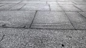 Textura de lajes do granito, câmera em um ângulo de flutuadores de 45 graus para a frente filme
