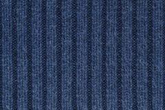 Textura de las lanas de los azules marinos que hace punto para el modelo y el fondo Imagen de archivo