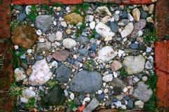 Textura de las piedras brillantes de los adoquines de los guijarros Imágenes de archivo libres de regalías
