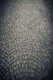 Textura de las tejas del pavimento de la piedra del adoquín Fotos de archivo