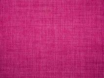 Textura de las telas de tapicería rosadas Imagen de archivo libre de regalías