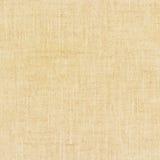 Textura de lino natural amarilla clara para el fondo Imagen de archivo